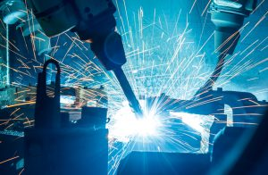 Robotic welders on an automotive manufacturing line provide an example of a smart factory environment.
