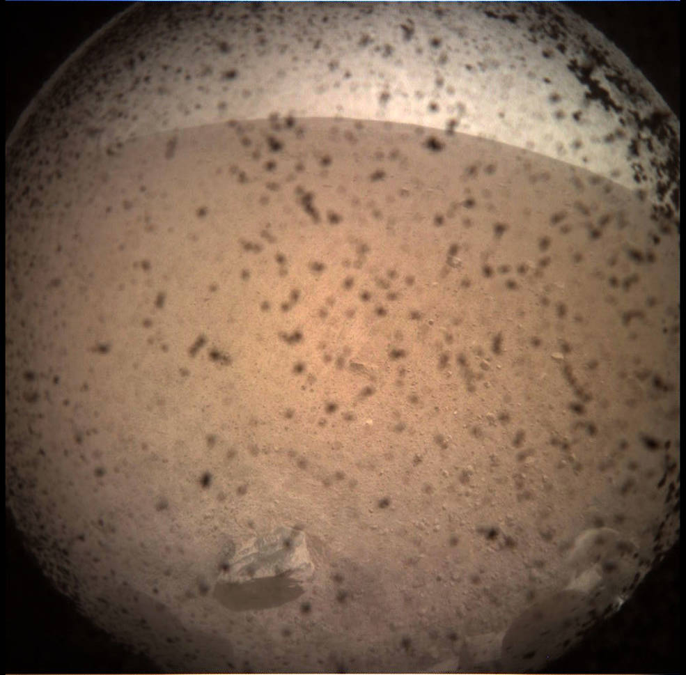 NASA's InSight Mars lander acquired this image of the area in front of the lander using its lander-mounted, Instrument Context Camera (ICC). This image was acquired on Nov. 26, 2018, Sol 0 of the InSight mission where the local mean solar time for the image exposures was 13:34:21. Each ICC image has a field of view of 124 x 124 degrees.
